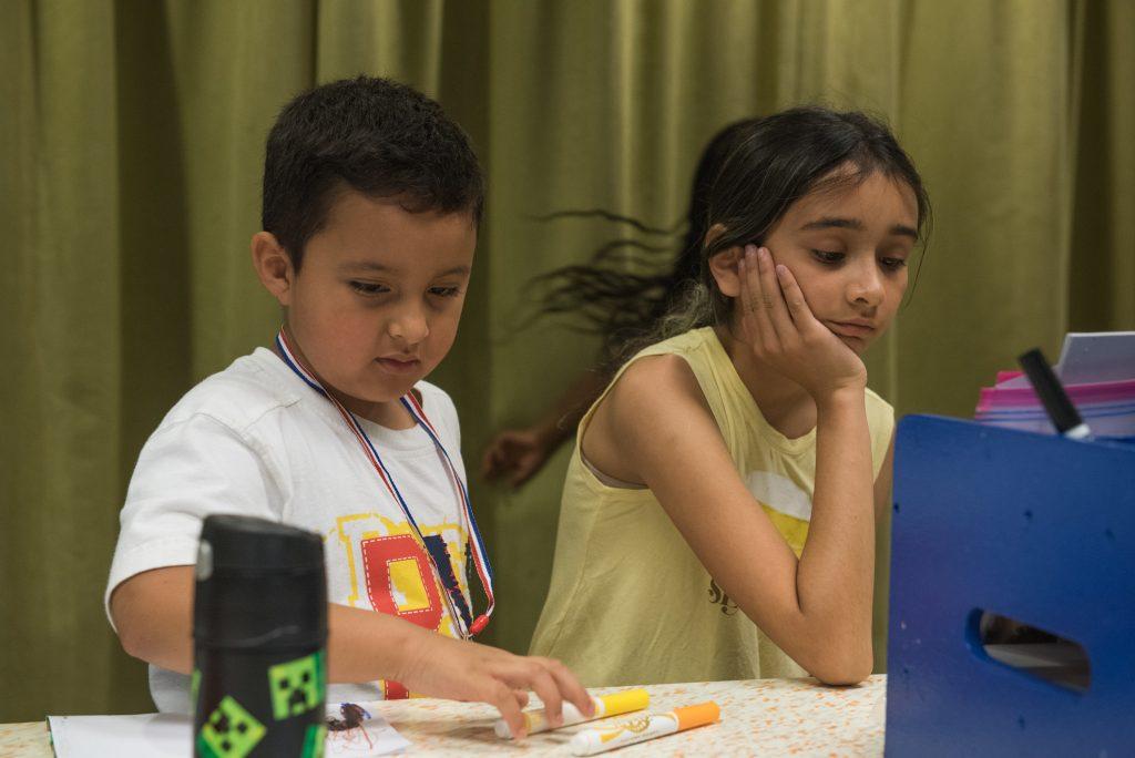 Two children attending a program at the library. © steven e gross 17919 Waukegan Public Library