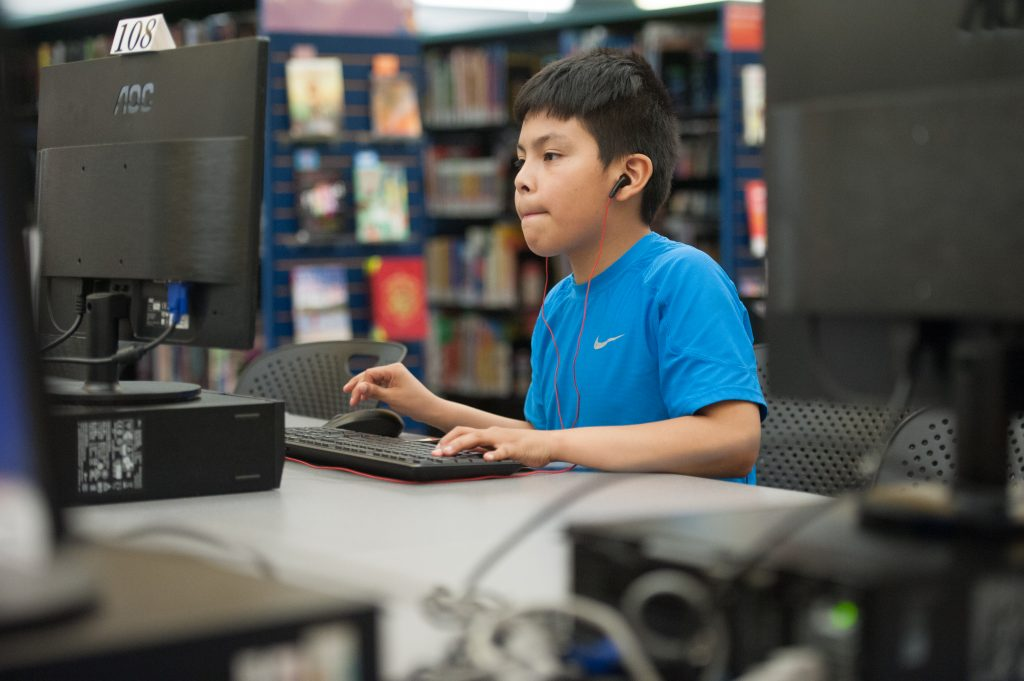 Child using a computer. © Steven E. Gross